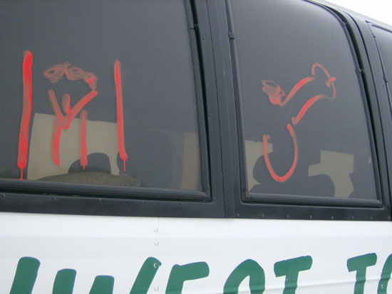 Defacement shows male and female genitalia