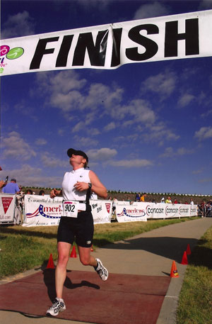 Wendy Boyer crossing the finish line